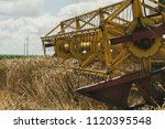 a large yellow harvester in the ... | Shutterstock . vector #1120395548
