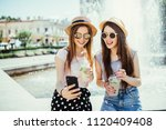 photo of pleased two mixed race ... | Shutterstock . vector #1120409408