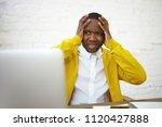 worried afro american... | Shutterstock . vector #1120427888