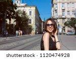 cheerful tanned brunette model... | Shutterstock . vector #1120474928
