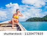 happy traveler asian woman in... | Shutterstock . vector #1120477835