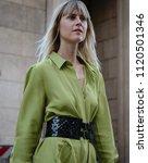 Small photo of MILAN, Italy- June 15 2018: Linda Tol on the street during the Milan Fashion Week