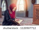 muslim woman reading koran or...   Shutterstock . vector #1120507712