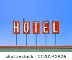 red hotel sign on top of a... | Shutterstock . vector #1120542926