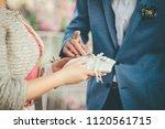 bridegroom is taking wedding... | Shutterstock . vector #1120561715