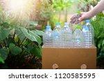 hand putting plastic bottle ... | Shutterstock . vector #1120585595