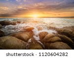 the storm on the rock beach... | Shutterstock . vector #1120604282