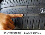 finger pointing at tyre... | Shutterstock . vector #1120610432