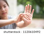 athlete shook hands to stretch... | Shutterstock . vector #1120610492