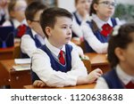 pupils at the desk think and... | Shutterstock . vector #1120638638