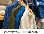 clothes on clothes rail in... | Shutterstock . vector #1120658828