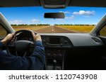 the man inside the car is... | Shutterstock . vector #1120743908