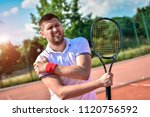 Shot Of A Tennis Player With A...