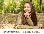 Young  Girl Smiling In Autumn...