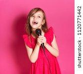 little 8 years old girl singing ... | Shutterstock . vector #1120771442
