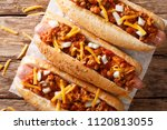 Chili Hot Dog With Cheddar...