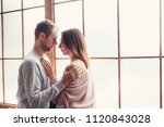 young loving couple stand near... | Shutterstock . vector #1120843028