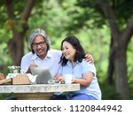 senior couple looking laptop... | Shutterstock . vector #1120844942