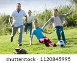 positive parents with two kids... | Shutterstock . vector #1120845995