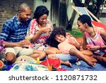 black family enjoying summer... | Shutterstock . vector #1120871732