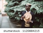 handsome afro american man in... | Shutterstock . vector #1120884215