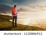 rear view of asian traveler man ... | Shutterstock . vector #1120886912