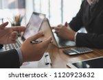 business adviser analyzing... | Shutterstock . vector #1120923632