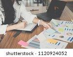 asian businesswoman write note... | Shutterstock . vector #1120924052