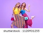 two playful sisters twins with... | Shutterstock . vector #1120931255