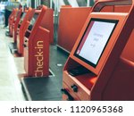 empty self check in machine at... | Shutterstock . vector #1120965368