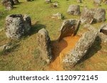 ancient stone jars in a plain... | Shutterstock . vector #1120972145