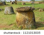 ancient stone jars in a plain...   Shutterstock . vector #1121013035