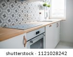 induction hob in modern... | Shutterstock . vector #1121028242