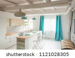 open bright kitchen with white... | Shutterstock . vector #1121028305