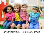 adorable curly boy embracing... | Shutterstock . vector #1121031935
