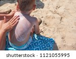 mother is putting on boy back a ... | Shutterstock . vector #1121055995