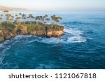 Small photo of Vacation on the beach of California. Sunset and backlight. Ocean View. Aerial view of Shaws Cove, Laguna Beach, California, USA.