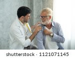 an old patient is consulting to ... | Shutterstock . vector #1121071145