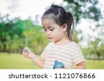 a little girl happy and walk in ... | Shutterstock . vector #1121076866