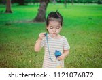 a little girl happy and walk in ... | Shutterstock . vector #1121076872