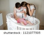 parents looking on their little ... | Shutterstock . vector #1121077505