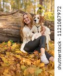 Stock photo young beautiful blonde walking with dog in the autumn park autumn sunny day 1121087972
