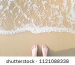 Top View Little Feet On Sea...