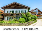 typical old farmhouse at the... | Shutterstock . vector #1121106725