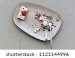 plate of ate cake left on floor | Shutterstock . vector #1121144996