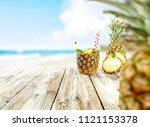 fresh pineapple and summer time.... | Shutterstock . vector #1121153378