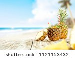 fresh pineapple and summer time.... | Shutterstock . vector #1121153432