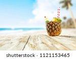 fresh pineapple and summer time.... | Shutterstock . vector #1121153465
