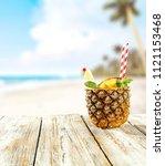 fresh pineapple and summer time.... | Shutterstock . vector #1121153468