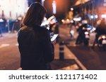 girl pointing finger on screen...   Shutterstock . vector #1121171402